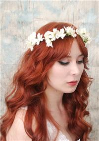 If you'd prefer to buy your crown, Etsy has the best selection online. This simple ivory piece is av