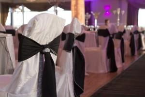 Chair Covers, White chair covers tied with a black sash with a diamante ring.
