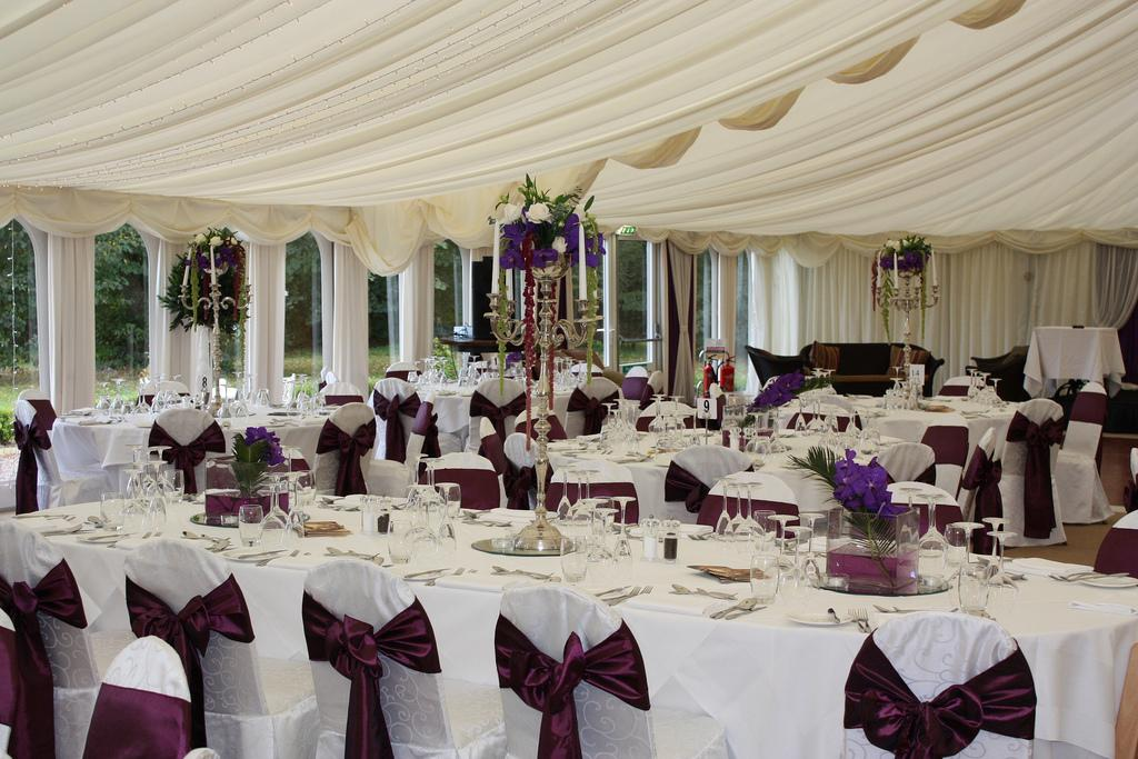 Chair Covers, White damask chair covers tied with a ruby stain sash.