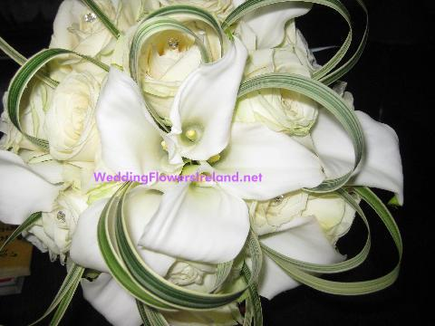 Flowers, Bride's bouquet (callas, roses and grasses). Wedding packages available.