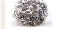 Flowers. Brooch Bouquet. All brooch bouquet with vintage style brooches and pearls. The handle is fi
