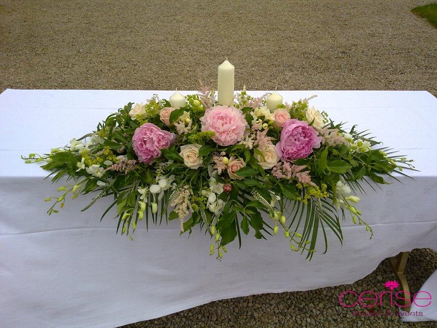 Flowers, Altar flower arrangement. Services provided: wedding flowers, chaircovers, table centrepiec