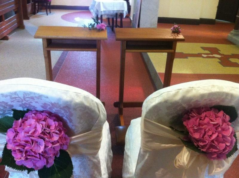 Flowers, Chair back flower arrangement. Wedding packages available.