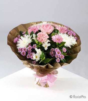 Flowers, Ella. A luxury hand-tied bouquet of pink and white flowers including freesias and roses. On