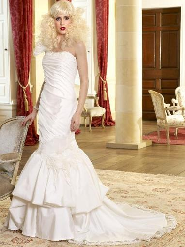 Bridal Dresses, Felice wedding dress. This dress has a one-shoulder organza  strap that leads into a